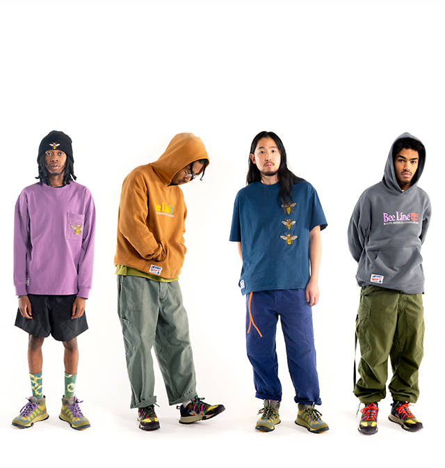 Men wearing Bee Line X Timberland Collaboration clothing and sneakers