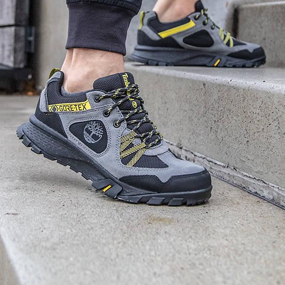 women's grey wedge sandals on cobblestones