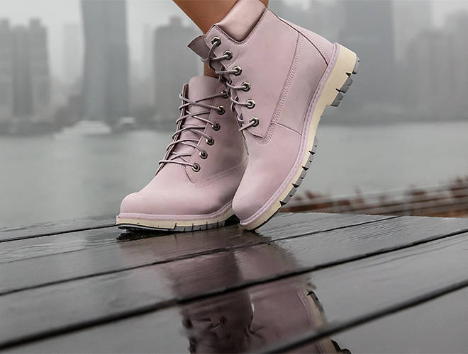 A close-up of a woman's pink boots