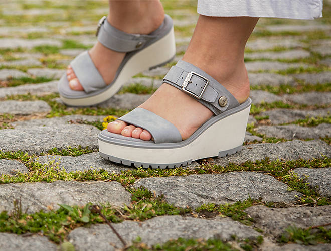 women's grey wedge sandals on cobblestones