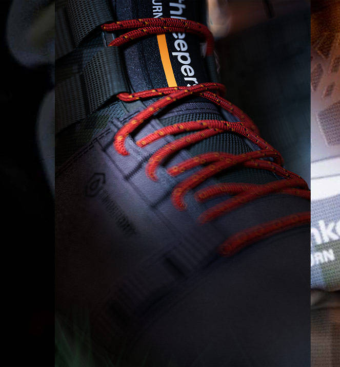 gray boot with orange laces