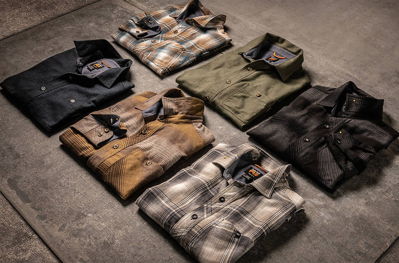 flannel shirts in many colors folded on a table