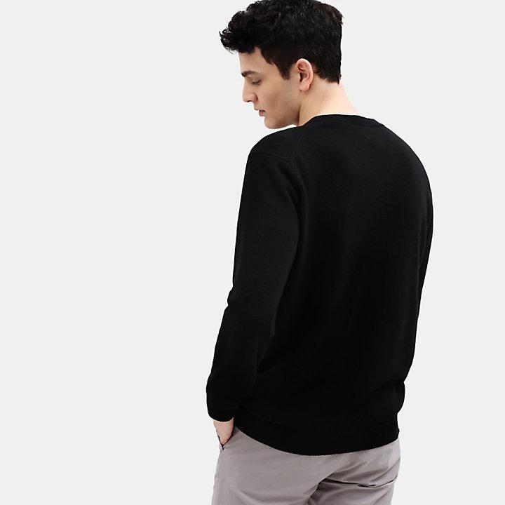 Pull à col en V en laine mérinos pour homme en noir-